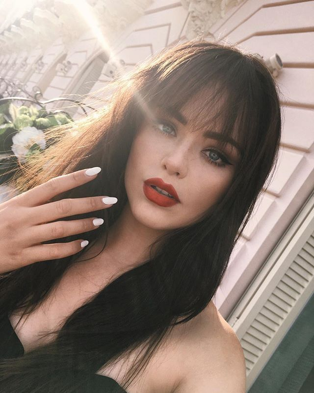 beauty hair brown hair with bangs long hair white nails red lipstick bangs how to wear your bangs more on fashionchick