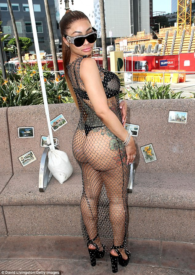 blac chyna flaunted her surgically enhanced behind in a fishnet maxi