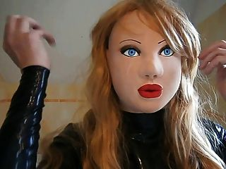 masked latex doll with blond wig tmb