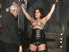 stunning brunette victim gets her tiny tits tortured in the sex basement