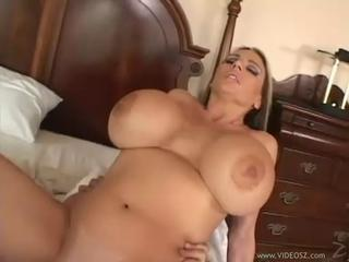 tattooed brunette with massive hooters rides big cannon 2